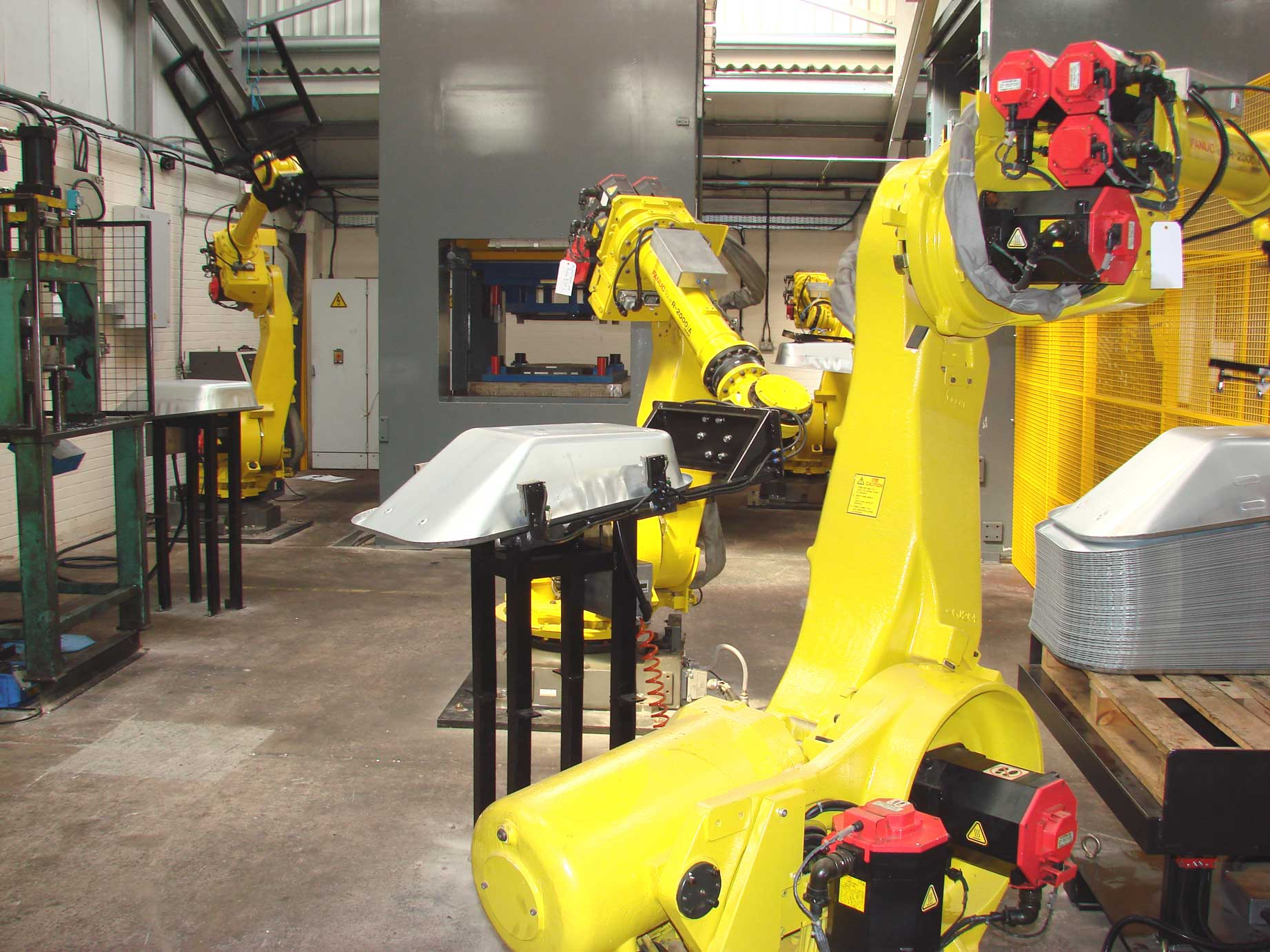 Wheelbarrow Pan Manufacture with 6 Fanuc Robots